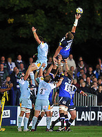 Stuart Hooper reaches to claim the ball at a lineout. Aviva Premiership match, between Bath Rugby and Northampton Saints on September 14, 2012 at the Recreation Ground in Bath, England. Photo by: Patrick Khachfe / Onside Images