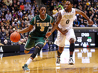 WEST LAFAYETTE, IN - DECEMBER 29: Marcus Thornton #3 of the William &amp; Mary Tribe dribbles the ball to the basket past Terone Johnson #0 of the Purdue Boilermakers at Mackey Arena on December 29, 2012 in West Lafayette, Indiana. Purdue defeated William &amp; Mary 73-66. (Photo by Michael Hickey/Getty Images) *** Local Caption *** Marcus Thornton; Terone Johnson
