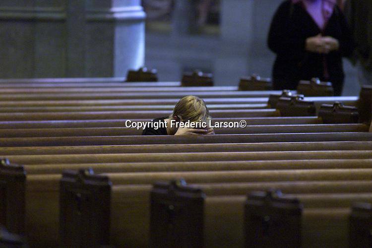People pray at Grace Cathedral, San Francisco, California.