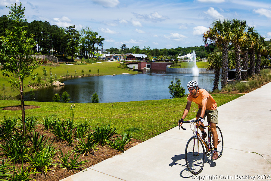 A cyclist rounds the turn on the trail at the southwest corner of Cascades Park's 2.5 mile trail system in Tallahassee.<br /> <br /> COLIN HACKLEY PHOTO