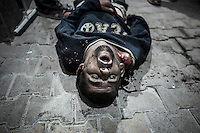 The dead body of Syrian civilian lies down on the street outside a hospital after was killed by mortar shelling in Tarik Al-Bab neighborhood in Aleppo City.