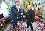 Peter Prove (left), director for international affairs of the World Council of Churches, greets Patriarch Louis Rafael Sako, president of the synod of the Chaldean Catholic Church, during the visit of an ecumenical delegation to Sako's office in Baghdad on January 21, 2017.