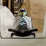 8 January 2016: Codie Bascue, piloting his 2-man bobsled for the United States of America, enters the Chicane straightaway on his second run, ending the day with a combined 2-run time of 1:51.49 and earning an 11th place finish at the BMW IBSF World Cup Championships at the Olympic Sports Track in Lake Placid, New York, USA. Mandatory Credit: Ed Wolfstein Photo *** RAW (NEF) Image File Available ***