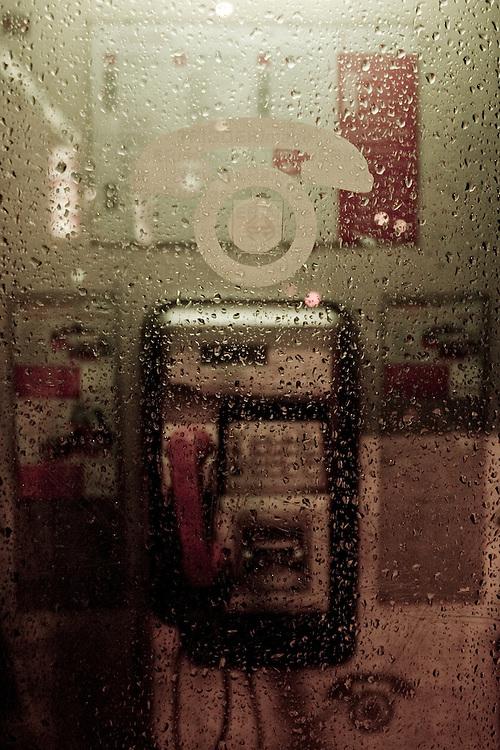 Telephone box in a rainy night