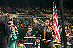 Felicia Vickerson waves to family and friends during fall commencement. Photo by Ben Siegel