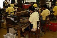 Workers in the Tabacalera Alberto Turrent  cigar factory near San Andres Tuxtla,  Veracruz, Mexico              .