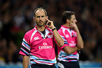 Referee Romain Poite consults the television match official (TMO) during a break in play. Rugby World Cup Pool C match between New Zealand and Namibia on September 24, 2015 at The Stadium, Queen Elizabeth Olympic Park in London, England. Photo by: Patrick Khachfe / Onside Images