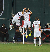Diego Fagundez (14) of the New England Revolution celebrates his score with teammates Dimitry Imbongo (92) The New England Revolution defeated D.C. Untied 2-1, at RFK Stadium, Saturday July 27 , 2013.