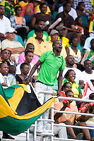 A Jamaican fan cheers on his team during the group stage of the CONCACAF Men's Under 17 Championship at Catherine Hall Stadium in Montego Bay, Jamaica. Jamaica defeated Guatemala, 1-0.