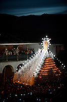 The procession of the Easter resurrection goes around the Plaza de Armas in Ayacucho, Peru, the final procession of the 10-day celebration. The religious float is hoisted by more than 300 men.