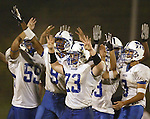 Middletown football players celebrate their 14-12 victory over host Washingtonville on Aug. 31, 2007.