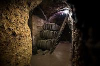 Oak barrels of Rioja wine at Carlos San Pedro Bodega winery in medieval town of Laguardia in Basque country, Spain