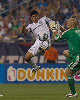 New England Revolution goalkeeper Matt Reis (1) blocks scoring attempt by second half substitute Chicago Fire defender Deris Umanzor (13). The Chicago Fire defeated the New England Revolution, 1-0, at Gillette Stadium on June 27, 2010.
