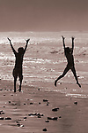 Kids playing in the surf on Sand Dollar Beach, Big Sur Coast, California USA