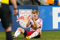 Dax McCarty (11) of the New York Red Bulls applauds the referee's call during the second half against Sporting Kansas City. Sporting Kansas City defeated the New York Red Bulls 1-0 during a Major League Soccer (MLS) match at Red Bull Arena in Harrison, NJ, on April 17, 2013.