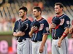 16 May 2012: Washington Nationals players (left to right) Bryce Harper, Xavier Nady, and Ryan Zimmerman stand at attention during the National Anthem prior to a game against the Pittsburgh Pirates at Nationals Park in Washington, DC. The Nationals defeated the Pirates 7-4 in the first game of their 2-game series. Mandatory Credit: Ed Wolfstein Photo