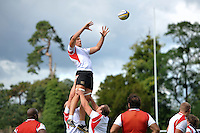 Charlie Ewels of Bath Rugby rises high to win lineout ball. Bath Rugby training session on September 4, 2015 at Farleigh House in Bath, England. Photo by: Patrick Khachfe / Onside Images