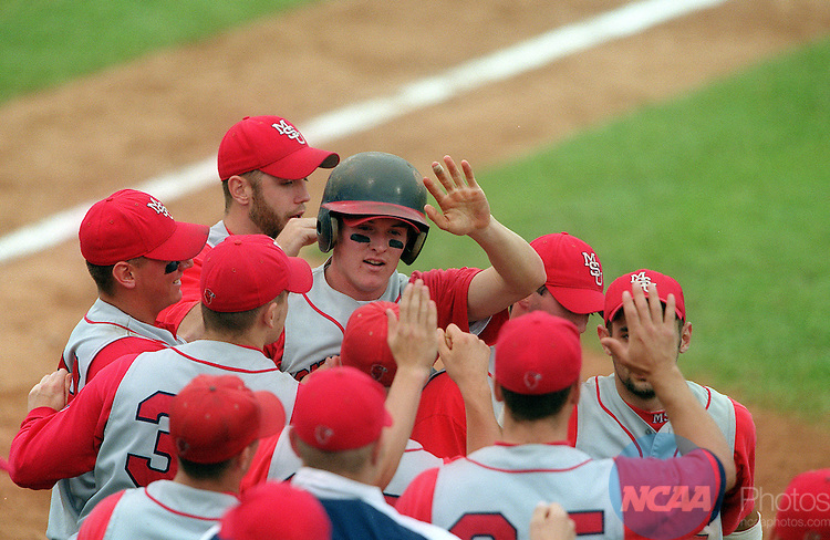 30 MAY 2000: Sophomore Brian Ellerson (7) of Montclair State University is congratulated at home plate after driving a two-run homer over the fence against the University of St. Thomas during the first game of the Division 3 Men's Baseball Championship held at Fox Cities Stadium in Grand Chute, WI.  Montclair State defeated the University of St. Thomas in consecutive games 13-3 and 6-2 to win the double elimination national championship title.  Allen Fredrickson/NCAA Photos