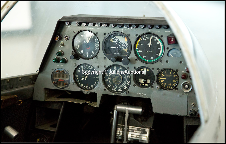 BNPS.co.uk (01202 558833)<br /> Pic: JuliensAuctions/BNPS<br /> <br /> ***Please Use Full Byline***<br /> <br /> The cockpit of the helicopter prop used in the James Bond film, You Only Live Twice. <br /> <br /> Est: &pound;200,000.<br /> <br /> The iconic micro-jet flown by Roger Moore in Octopussy and the swivel chair used by super-villain Blofeld are among a host of props from James Bond movies coming up for sale.<br /> <br /> The 12ft long BD-5J red, white and blue aircraft, that is the world's lightest jet, was piloted by 007 in the opening scenes of Octopussy, outwitting his Cuban captors.<br /> <br /> The aircraft was actually built seven years before the film as part of an air display team and was hired for the 1983 Bond flick.