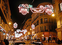 Night scene in Calle Marques De Larios, Malaga, Spain, during carnival. .Ref: 200202123296..Copyright Image from Victor Patterson, 54 Dorchester Park, Belfast, UK, BT9 6RJ..Tel: +44 28 9066 1296.Mob: +44 7802 353836.Voicemail +44 20 8816 7153.Skype: victorpattersonbelfast.Email: victorpatterson@mac.com.Email: victorpatterson@ireland.com (back-up)..IMPORTANT: If you wish to use this image or any other of my images please go to www.victorpatterson.com and click on the Terms & Conditions. Then contact me by email or phone with the reference number(s) of the image(s) concerned.