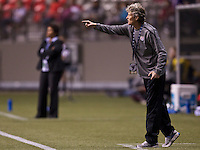 United States head coach Pia Sundhage shouts instructions from the sidelines during play between the United States and Costa Rica in the CONCACAF Olympic Qualifying semifinal match at BC Place in Vancouver, B.C., Canada Friday Jan. 27, 2012. The United States won the match 3-0 to earn a berth in 2012 London Olympics.