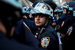 Police officers keep an eye on people while protesters of the Occupy Wall Street movement celebrate their first anniversary with marches and confrontations with the New York police where 150 protesters have been arrested during weekend celebrations in Manhattan.  Photo by Eduardo Munoz Alvarez / VIEWpress.