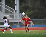 Oxford High's Michelle Reid (23) vs. Lafayette High's Maddie Houghton (20) in girls high school soccer in Oxford, Miss. on Saturday, December 8, 2012.
