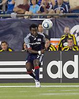 New England Revolution forward Kenny Mansally (7) crosses the ball. The New England Revolution tied Columbus Crew, 2-2, at Gillette Stadium on September 25, 2010.