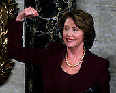 "Washington, D.C. - January 4, 2007 --  United States Representative Nancy Pelosi (Democrat of the 8th District of California) shows her ""muscle"" after she was sworn-in as the Speaker of the United States House of Representatives in the Capitol in Washington, D.C. on Thursday, January 4, 2007.  Speaker Pelosi is the first woman in U.S. history to serve in that position..Credit: Ron Sachs / CNP"