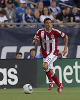 Chivas USA defender Zarek Valentin (20) brings the ball forward. In a Major League Soccer (MLS) match, Chivas USA defeated the New England Revolution, 3-2, at Gillette Stadium on August 6, 2011.