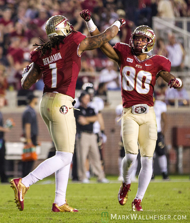 Wide receivers Kelvin Benjamin and Rashad Greene celebrate Benjamin's touchdown when the #2 ranked Florida State Seminoles defeated the Idaho Vandals 80-14 at Doak S Campbell Stadium in Tallahassee, Florida.