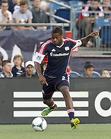 New England Revolution defender Andrew Farrell (2) dribbles. In a Major League Soccer (MLS) match, the New England Revolution (blue) tied D.C. United (white), 0-0, at Gillette Stadium on June 8, 2013.