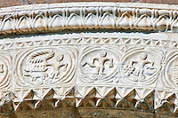 13th century Romanesque decorative marble archivolt of the main portal with decorative marble relief sculptures of the signs of the Zodiac and the work of the seasons on the 8th century Romanesque Basilica church of St Peters, Tuscania, Lazio, Italy