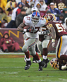 Landover, MD - November 30, 2008 -- New York Giants running back Brandon Jacobs (27) carries the ball in third quarter action against the Washington Redskins at FedEx Field in Landover, Maryland on Sunday, November 30, 2008.  The Giants won the game 23 - 7..Credit: Ron Sachs / CNP.(RESTRICTION: No New York Metro or other Newspapers within a 75 mile radius of New York City)