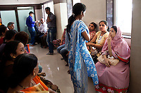 Patients, surrogates, and clients wait in the reception area in the Akanksha Infertility Clinic in the small town of Anand, Gujarat, India. .The Akanksha Infertility Clinic is known internationally for its surrogacy program and currently has over a hundred surrogate mothers pregnant in their environmentally controlled surrogate houses.