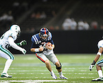 Ole Miss quarterback Bo Wallace (14) vs. Tulane's Logan Hamilton (63) in the first half at the Mercedes-Benz Superdone in New Orleans, La. on Saturday, September 22, 2012. Ole Miss won 39-0...