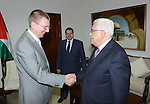 Palestinian President Mahmoud Abbas meets with the Minister of Foreign Affairs of Latvia Edgars Rinkevics at the Palestinian Authority headquarter in the West Bank city of Ramallah on Oct. 31, 2012. Photo by Thaer Ganaim