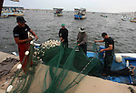 Palestinian fishermen prepare their nets at Gaza Seaport in Gaza City September 30, 2012. Israel confines fishermen within a three-mile fishing zone in the Mediterranean Sea off the coast of Gaza, Palestinian fishermen syndicate said. A Palestinian man died on Saturday after he was shot by Israeli troops while fishing on the beach in the Gaza Strip, said Hamas officials, while an Israeli military spokeswoman said the man was shot when he approached the border fence. Photo by Ashraf Amra