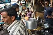 Local residents stop for a cup of tea in the busy marketplace in Jharia, outside of Dhanbad in Jharkhand, India.  Photo: Sanjit Das/Panos