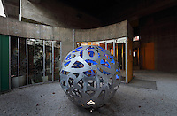 Globe sculpture by Brazilian sculptor Darlan Rosa at the Maison du Bresil or Brazil House, designed by Le Corbusier (Charles-Edouard Jeanneret, 1887-1965) and Lucio Costa, 1902-1998, and inaugurated in 1954, in the Cite Internationale Universitaire de Paris, in the 14th arrondissement of Paris, France. The building is listed as a historic monument. The CIUP or Cite U was founded in 1925 after the First World War by Andre Honnorat and Emile Deutsch de la Meurthe to create a place of cooperation and peace amongst students and researchers from around the world. It consists of 5,800 rooms in 40 residences, accepting another 12,000 student residents each year. Picture by Manuel Cohen. L'autorisation de reproduire cette œuvre doit etre demandee aupres de l'ADAGP/Permission to reproduce this work of art must be obtained from DACS.