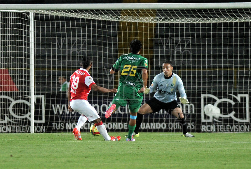 BOGOTA - COLOMBIA -24 -09-2014: Wilson Morelo (Izq.) jugador de Independiente Santa Fe, anota gol a Diego Novoa (Der.), portero de La Equidad, durante partido entre Independiente Santa Fe y La Equidad, por la fecha 11 de la Liga Postobon II-2014, en el estadio Nemesio Camacho El Campin de la ciudad de Bogota.  / Wilson Morelo (L), player of Independiente Santa Fe, scored a goal to Diego Novoa (R),  goalkeeper of La Equidad, during a match between Independiente Santa Fe and La Equidad, for the date 11of the Liga Postobon II -2014 at the Nemesio Camacho El Campin Stadium in Bogota city, Photo: VizzorImage  / Luis Ramirez / Staff.