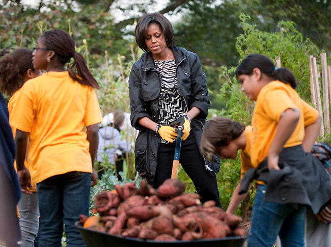 Oct 20, 2010 - Washington, District of Columbia, U.S. - First Lady MICHELLE OBAMA and students from local Washington, D.C. schools participate in the White House Kitchen Garden Fall Harvest. As part of her Let's Move! campaign to reduce childhood obesity, Mrs. Obama spoke about the importance of eating fruits and vegetables, shared withthe students lessons about where their food comes from and how that impacts their health. (Credit Image: &copy; Pete Marovich/ZUMA Press)