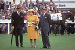 The Queen at the Derby racecoure. The English Season published by Pavilon Books 1987. On her left is Lord Porchester the Earl Carnarvon,