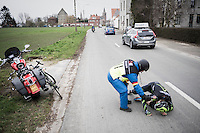 Ben Perry (CAN/Israel Cycling Academy) crashes in the back of the peloton &amp; is helped by a road marchal <br /> <br /> 69th Kuurne-Brussel-Kuurne 2017 (1.HC)