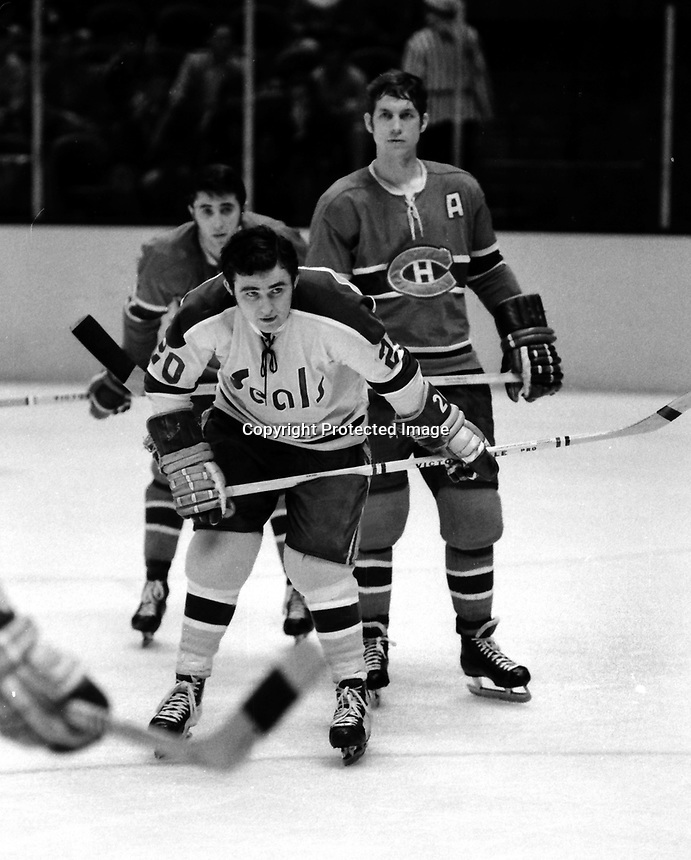 Seals Bill Hickey against the Montreal Canadiens, (1971 photo.<br />