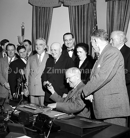 Sam Rayburn, Speaker of the House of Representatives, receives gavel from President Truman for having served longer as Speaker than anyone in history. Gavel was made of wood used to rebuild White House in 1817 after the British burned it. White House, 1952. CREDIT: JOHN G. ZIMMERMAN