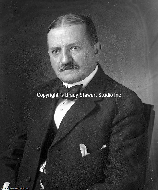 Wilkinsburg PA:  Homer Stewart sitting for a portrait at B.W. Stewart Studio in Wilkinsburg.  Homer needed the photo for Public Relations at The Colonial Trust Company where he was Treasurer.  The Colonial Trust Company merged with Pittsburgh National Bank later in his career.