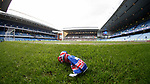 Discarded Rangers scarf on the pitch at full -time as Celtic celebrate to their fans