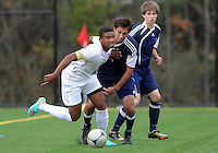 HYATTSVILLE, MD - OCTOBER 26, 2012:  Sean Cowdrey (10) of DeMatha Catholic High School gets away from Arjan Ganji (10) of St. Albans during a match at Heurich Field in Hyattsville, MD. on October 26. DeMatha won 2-0.