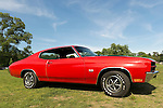 Old Westbury, New York, U.S. - June 1, 2014 -  An iconic red with black stripes muscle car 1970 Chevrolet Chevelle SS 396 - 350 base model, was brought by its owner JOHN McALEESE of SEAFORD, a visitor at the Antique and Collectible Auto Show held on the historic grounds of elegant Old Westbury Gardens in Long Island, and sponsored by Greater New York Region AACA Antique Automobile Club of America.